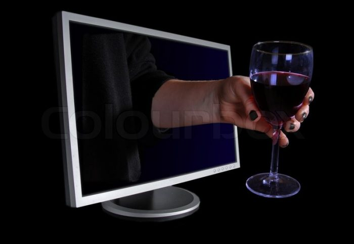 1149511-hand-with-a-glass-of-wine-coming-out-through-a-computer-screen
